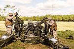 October 22, 2014. Camp LeJeune, North Carolina.<br />  Pfc. Livier Vielehr, right, of artillery Battery A of the Ground Combat Element Integrated Task Force, works to set up one of her unit's M777 howitzers. Pfc. Vielehr has the MOS of field artillery cannoneer (0811), a job previously closed to women.<br />  The Ground Combat Element Integrated Task Force is a battalion level unit created in an effort to assess Marines in a series of physical and medical tests to establish baseline standards as the Corps analyze the best way to possibly integrate female Marines into combat arms occupational specialities, such as infantry personnel, for which they were previously not eligible. The unit will be comprised of approx. 650 Marines in total, with about 400 of those being volunteers, both male and female. <br />  Jeremy M. Lange for the Wall Street Journal<br /> COED