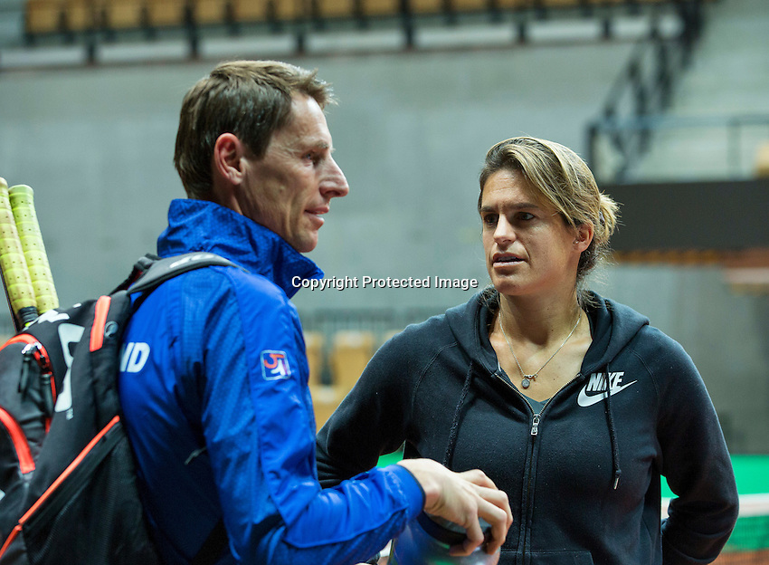 2016, 12 April, Arena Loire, Trélazè,  Semifinal FedCup, France-Netherlands,  Dutch captain Paul Haarhuis and French Captain Amelie Mauresmo meet<br /> Photo:Tennisimages/Henk Koster