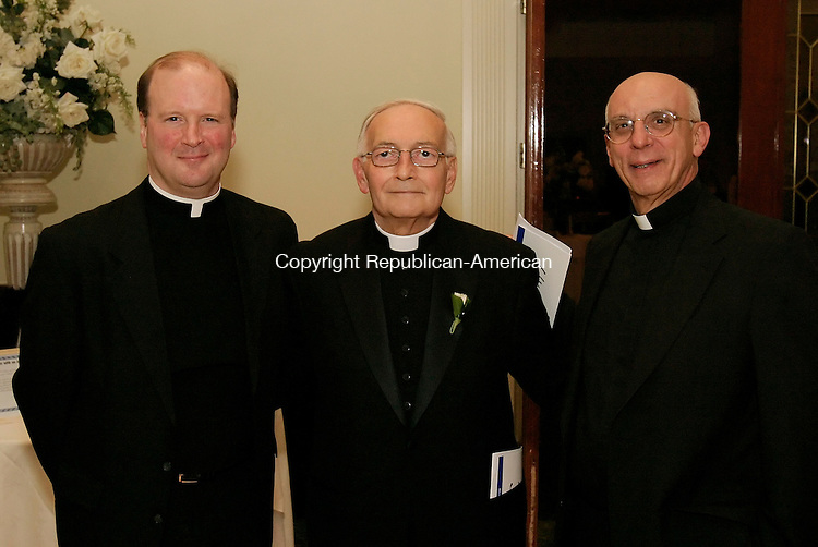 WATERBURY, CT 5 November 2005 -110505BZ12-  <br /> From left- Msgr. Thomas Ginty, pastor of Our Lady of Loreto; Father Richard Bollea, chaplain at Waterbury Hospital, being honored as the 2005 Humanitarian Award Winner; Father Paul J. Pace, pastor at Saint Francis Xavier;<br /> <br /> during &quot;Diamonds and Ice, A White Glove Affair&quot; to benefit Waterbury Hospital's portion of the Heart Center of Greater Waterbury.  The event was held at Villa Rosa Saturday night.<br /> <br /> <br /> <br /> Jamison C. Bazinet Republican-American