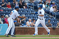Adam Moore (15) of the Durham Bulls prepares to shake hands with Durham Bulls third base coach Ben Johnson (30) as he rounds the bases after hitting a solo home run against the Buffalo Bison at Durham Bulls Athletic Park on April 25, 2018 in Allentown, Pennsylvania.  The Bison defeated the Bulls 5-2.  (Brian Westerholt/Four Seam Images)