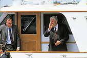 United States President George H.W. Bush, left, and President Boris Yeltsin of the Russian Federation, right, wave to the photographers as they take a boat ride on the Severn River in Maryland on June 17, 1992. <br />