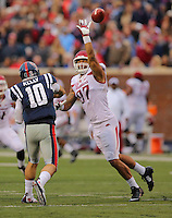 11/7/15<br /> Arkansas Democrat-Gazette/STEPHEN B. THORNTON<br /> Arkansas' Tevin Beanum, right, tips a pass by   Ole Miss' QB Chad Kelly during the second quarter of Saturday's game in Oxford, Miss.