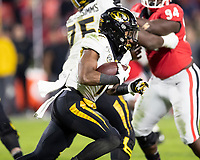 ATHENS, GA - NOVEMBER 09: Tyler Badie #1 of the Missouri Tigers runs with the ball during a game between Missouri Tigers and Georgia Bulldogs at Sanford Stadium on November 09, 2019 in Athens, Georgia.