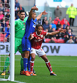 4th November 2017, Ashton Gate, Bristol, England; EFL Championship football, Bristol City versus Cardiff City; Bobby Reid of Bristol City, Lee Peltier of Cardiff City and Neil Etheridge of Cardiff City compete for space in the goal mouth