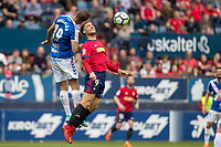SADAR, PAMPLONA, SPAIN: La Liga de Fútbol, ​​CA Osasuna vs Tenerife; Quique, player of Osasuna, wins for a ball against Aveldaño, player of Tenerife during the match of Liga 123, on April 1, 2018