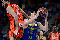 Valencia Basket's Pierre Oriola and Herbalife Gran Canaria's Anzejs Pasecniks during Quarter Finals match of 2017 King's Cup at Fernando Buesa Arena in Vitoria, Spain. February 17, 2017. (ALTERPHOTOS/BorjaB.Hojas) /Nortephoto.com
