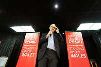 Pictured: Jeremy Corbyn adjusts his glasses as he takes to the stage at Barry Island Sports and Social Club. Saturday 07 December 2019<br /> Re: Labour Party leader Jeremy Corbyn pre-election campaign in Barry, south Wales, UK.