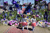 Young twin girls paying homage to Prince rendered in a large painting. Paisley Park Studios Chanhassen Minnesota MN USA