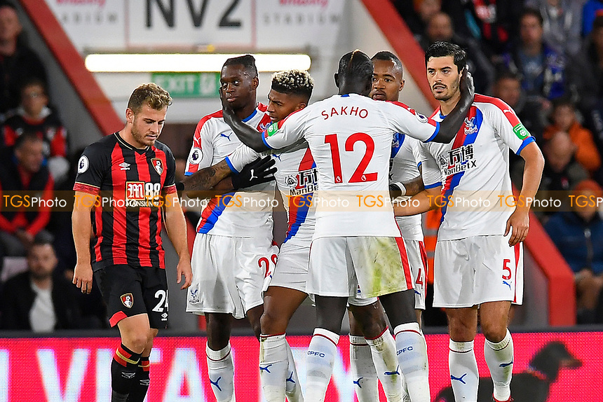 Crystal Palace players celebrate the goal scored by Patrick van Aanholt of Crystal Palace as Ryan Fraser of AFC Bournemouth left looks unimpressed during AFC Bournemouth vs Crystal Palace, Premier League Football at the Vitality Stadium on 1st October 2018