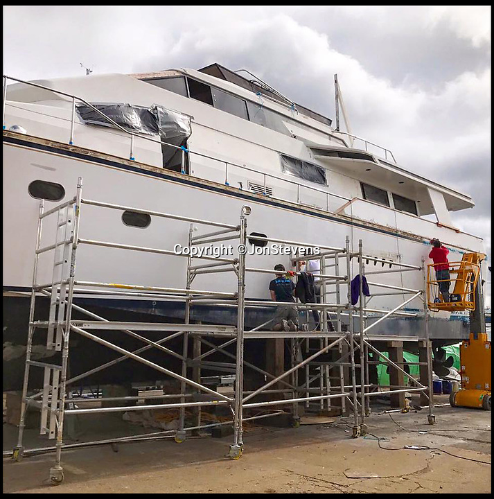 BNPS.co.uk (01202 558833)<br /> Pic: JonStevens/BNPS<br /> <br /> Under restoration.<br /> <br /> Who says crime doesn't pay...<br /> <br /> A couple are planning their dream life on the water after they bought a criminal's multi-million super yacht for a knock down price of £66,000.<br /> <br /> Jon and Louise Stevens bought the 85ft motor yacht 'The Cavier' in a government auction after it was seized by the police.<br /> <br /> The vessel had been abandoned in a wharf in Southampton, Hants, for 13 years and as a result was in a run down state when the couple took it over.