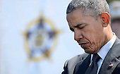 United States President Barack Obama reflects during the National Peace Officers Memorial Service, an annual ceremony honoring law enforcement who were killed in the line of duty in the previous year, at the US Capitol in Washington, DC, May 15, 2015.<br /> Credit: Olivier Douliery / Pool via CNP