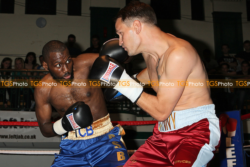 Diego Burton (blue/gold shorts) defeats Danny Brown in a Middleweight boxing contest at York Hall, Bethnal Green, promoted by Miranda Carter/Left Jab Promotions - 18/09/11 - MANDATORY CREDIT: Gavin Ellis/TGSPHOTO - Self billing applies where appropriate - 0845 094 6026 - contact@tgsphoto.co.uk - NO UNPAID USE.