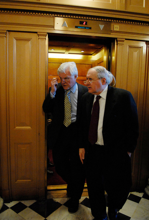 Sens. Ted Kennedy, D-Mass., and Carl Levin, D-Mich., make their way to a vote in the Senate Chamber.