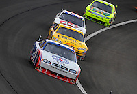 Feb 22, 2009; Fontana, CA, USA; NASCAR Sprint Cup Series driver Sam Hornish Jr leads a pack of cars during the Auto Club 500 at Auto Club Speedway. Mandatory Credit: Mark J. Rebilas-