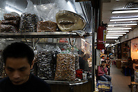 Guangzhou Dried Fish Market in downtown, Guangzhou, China..Initially reef fish only came from the South China Sea, but transport developed and fish now come from all over S.E. Asia.  The whole reef fish trade crashed with the 97-98 HK stock market crash.  LRF trade is directly linked to economy.  With China coming online financially the trade is booming.  These fish are often used for celebratory meals in Hong Kong, but in Guangzhou the fish are so cheap and the apartments are so small that many people eat out...  And the stereotype is that there is lots of food left on the table.  Often a fish is popular because of its color... more than its taste.