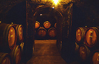 The Tibor Gal (GIA) winery in Eger (famous for Egri Bikaver): underground tunnels with rows of barrels, dark corridors, old wooden doors. Tibor Gal is one of the leading growers and wine makers in Eger. The company was founded in 1993 in collaboration with Nicolo Incisa della Rochetta (Sassicaia, Italy) and Alpine from Germany