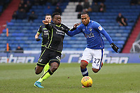 Oldham Athletic's Gevaro Nepomuceno (right) battles for possession with Bristol Rovers' Marc Bola (left) during the Sky Bet League 1 match between Oldham Athletic and Bristol Rovers at Boundary Park, Oldham, England on 30 December 2017. Photo by Juel Miah / PRiME Media Images.