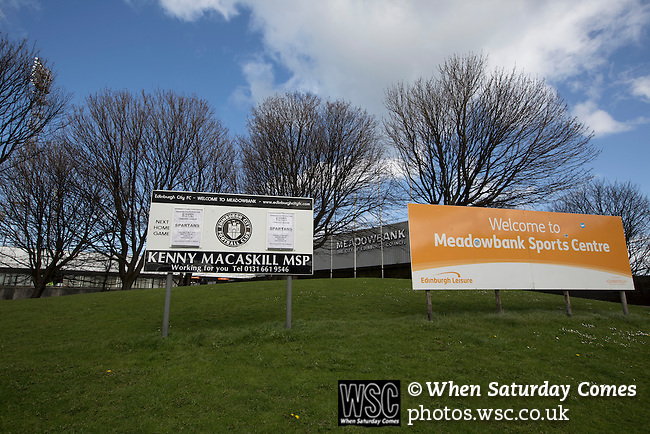 Edinburgh City v Spartans, 11/04/2015. Commonwealth Stadium, Scottish Lowland League. Advertising signs for the Scottish Lowland League match between Edinburgh City and city rivals Spartans at the Commonwealth Stadium, Meadowbank, which was won by the hosts by 2-0. Edinburgh City were the 2014-15 league champions and progressed to a play-off to decide whether there would be a club promoted to the Scottish League for the first time in its history. The Commonwealth Stadium hosted Scottish League matches between 1974-95 when Meadowbank Thistle played there. Photo by Colin McPherson.
