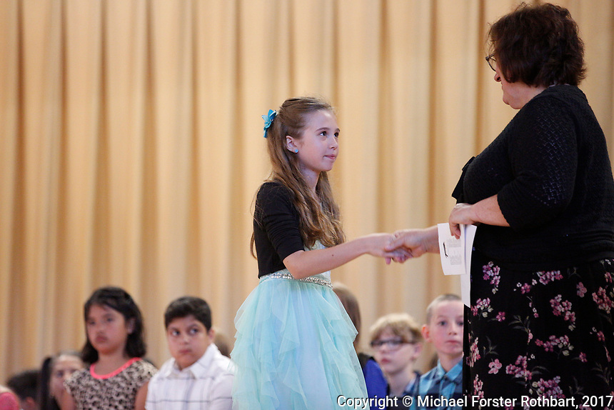 The Oneonta Greater Plains elementary school fifth grade awards ceremony, on June 21, 2017.<br /> &copy; Michael Forster Rothbart Photography<br /> www.mfrphoto.org &bull; 607-267-4893<br /> 34 Spruce St, Oneonta, NY 13820<br /> 86 Three Mile Pond Rd, Vassalboro, ME 04989<br /> info@mfrphoto.org<br /> Photo by: Michael Forster Rothbart<br /> Date:  6/21/2017<br /> File#:  Canon &mdash; Canon EOS 5D Mark III digital camera frame C19173
