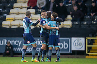 Celebrations as Adebayo Akinfenwa of Wycombe Wanderers opens the scoring during the Sky Bet League 2 match between Notts County and Wycombe Wanderers at Meadow Lane, Nottingham, England on 10 December 2016. Photo by Andy Rowland.