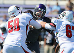 SIOUX FALLS, SD - SEPTEMBER 6: Grant Schindler #57 from the University of Sioux Falls fights through the block of Logan Gunderson #58 and Chad Sickles #67 from Minot State in the first quarter of their game Saturday afternoon at Bob Young Field in Sioux Falls.  (Photo by Dave Eggen/Inertia)