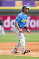 Zach Cone (12) of the Myrtle Beach Pelicans takes his lead off of third base against the Winston-Salem Dash at BB&T Ballpark on May 7, 2014 in Winston-Salem, North Carolina.  The Pelicans defeated the Dash 5-4 in 11 innings.  (Brian Westerholt/Four Seam Images)