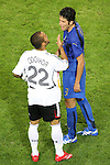 04 July 2006: David Odonkor (GER) (22) has words with Fabio Grosso (ITA) (3). Italy defeated Germany 2-0 in overtime at Signal Iduna Park, better known as Westfalenstadion, in Dortmund, Germany in match 61, the first semifinal game, in the 2006 FIFA World Cup.