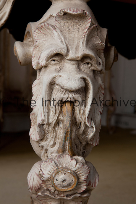 One of the many open mouthed carved faces on the Italian styled dressing table