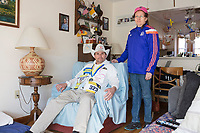 Carlos Arredondo, 57, (left) and his wife Melida Arredondo, 52, are seen in their home in Roslindale, Boston, Massachusetts, USA, on Sat., March 31, 2018. Arredondo is well known as the &quot;man in the cowboy hat&quot; who helped out in the aftermath of the Boston Marathon Bombing in 2013. Carlos is wearing a jacket that he has used to create a t-shirt design for when he runs the Boston Marathon later this year. Though he has run the race unofficially previously, this will be the first time he runs it &quot;legally,&quot; he says.<br /> <br /> Carlos' son Brian Arredondo, who can be seen in the photo on the wall above Carlos, died by suicide in 2011 after a battle with depression following the 2004 death of Arrendondo's other son  Marine Lance Corporal Alexander Scott Arredondo, who was killed while serving in Iraq.
