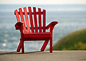 An Adirondack chair looks out over the waters of the Bay of Fundy in Nova Scotia, Canada.