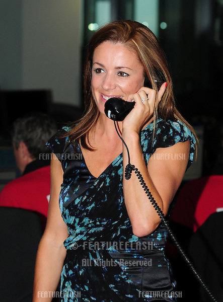 Natalie Pinkman takes to the trading floor at BGC in Canary Wharf as part of the fundraising day set up after the 9/11 terrorist attacks. 12/09/2011 Picture by: Simon Burchell / Featureflash