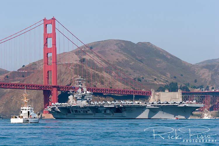 The nuclear powered aircraft carrier USS Nimitz (CVN-68) passes under the Golden Gate Bridge as it enters San Francisco Bay during the 2006 San Francisco Fleet Week Parade of Ships. The ship was named for Fleet Admiral Chester W. Nimitz, who commanded the Pacific fleet in World War II and was the Navy's last five-star admiral.