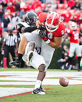 The Georgia Bulldogs beat the App State Mountaineers 45-6 in their homecoming game.  After a close first half, UGA scored 31 unanswered points in the second half.  Georgia Bulldogs tight end Hugh Williams (84), Appalachian State Mountaineers defensive back Kevin Walton (13)