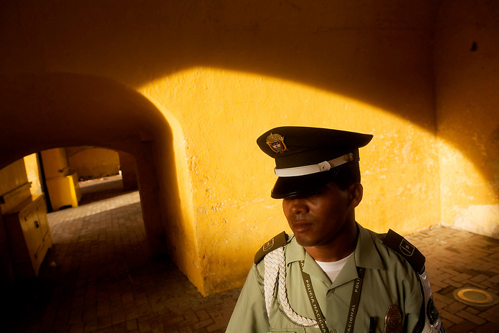 CARTAGENA, COLOMBIA - AUGUST:  Portrait of a police officer at the Torre de Reloj in Cartagena, Colombia in August 2007.  (Photo by Dennis Drenner/Aurora)..