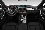 Stock photo of straight dashboard view of 2017 BMW 3-Series 330e-iPerformance 4 Door Sedan Dashboard