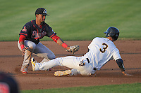 Eliezer Alvarez (15) of the Peoria Chiefs tags out Jordan Serena (3) of the Burlington Bees at second base during the game against the Bees at Community Field on June 9, 2016 in Burlington, Iowa.  Peoria won 6-4.  (Dennis Hubbard/Four Seam Images)