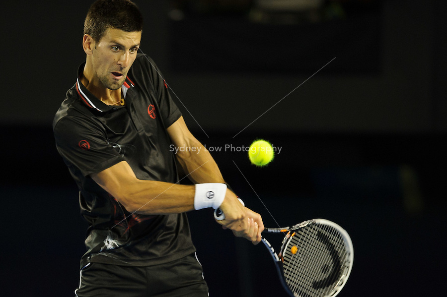 MELBOURNE, 23 JANUARY - Novak Djokovic (SRB) in action against Lleyton Hewitt (AUS) during a 4th round men's singles match on day eight of the 2012 Australian Open at Melbourne Park, Australia. (Photo Sydney Low / syd-low.com)