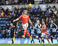 Cameron McGeehan of Luton Town heads the ball on during the Sky Bet League 2 match between Wycombe Wanderers and Luton Town at Adams Park, High Wycombe, England on 6 February 2016. Photo by Liam Smith.