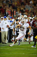 LOS ANGELES, CA - October 29, 2011:  Andrew Luck scrambles for a first down during Stanford's Pac-12 victory over the USC Trojans.  Stanford won in triple overtime, 56 -48, and extended its winning streak to 16 games.