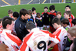 XXJOB 18-11-2015: Eamonn Fitzmaurice, team manager Pobalscoil Scoil Chorca Dhuibhne offers words of comfort to his palyers after St. Brendan's College won the Munster u-15 footbal final in Killarney on wednesday.<br /> Picture by Don MacMonagle