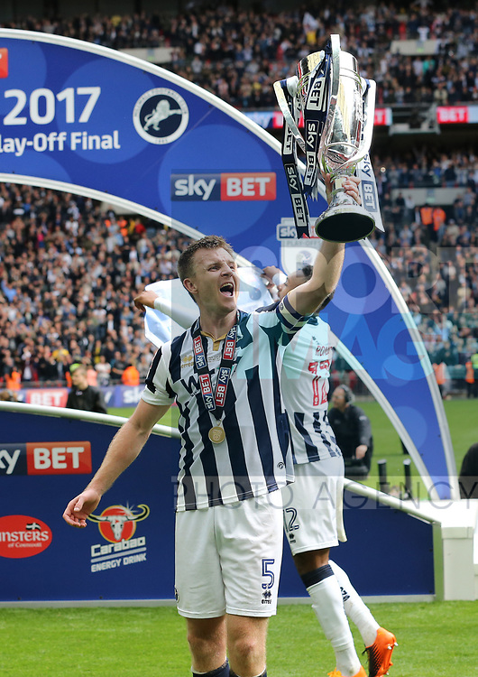 Millwall's Tony Craig celebrates with the trophy during the League One Play-Off Final match at Wembley Stadium, London. Picture date: May 20th, 2017. Pic credit should read: David Klein/Sportimage