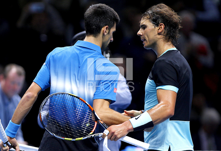 Rafael Nadal of Spain shakes hands with Novak Djokovic of Serbia at the net at the ATP World Tour Finals, The O2, London, 2015