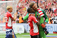Charlton goalkeeper, Dillon Phillips hugs Mark Marshall after the final whistle as Charlton celebrate promotion to the Championship during Charlton Athletic vs Sunderland AFC, Sky Bet EFL League 1 Play-Off Final Football at Wembley Stadium on 26th May 2019