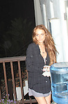 4-14-09  ..Lindsay Lohan left the night club Bardot in Hollywood ca then had her driver take her home. Lindsay went inside her house & gathered up a carton of eggs & began throwing them at the photographers. This is the only picture of Lindsay with the eggs in her hand. .The police showed up minutes later. Picture of a fat photographer hosing the eggs off his car....AbilityFilms@yahoo.com.805-427-3519.www.AbilityFilms.com.
