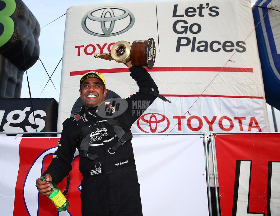 Feb 9, 2014; Pomona, CA, USA; NHRA top fuel dragster driver Khalid Albalooshi celebrates after winning the Winternationals at Auto Club Raceway at Pomona. Mandatory Credit: Mark J. Rebilas-