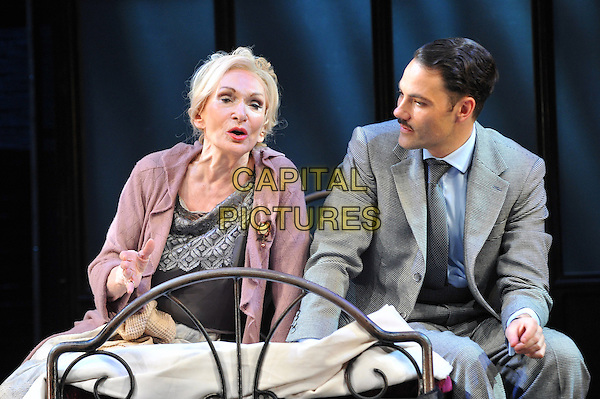 Sian Phillips and Matt Rawle.'Cabaret' at The Savoy Theatre - photocall, London, England..October 8th, 2012.stage performance performing acting play musical costume half length sitting bed profile grey gray suit pink jacket profile .CAP/CJ.©Chris Joseph/Capital Pictures.