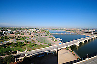 Tempe, Arizona. An aerial western view of Tempe Town Lake showing four of its bridges: the Mill Avenue bridges (right bottom); the Light Rail bridge (center); and, the pedestrian bridge (with white archs just above light rail bridge). The Tempe Beach Park is seen on the left. Photo By Eduardo Barraza © 2019