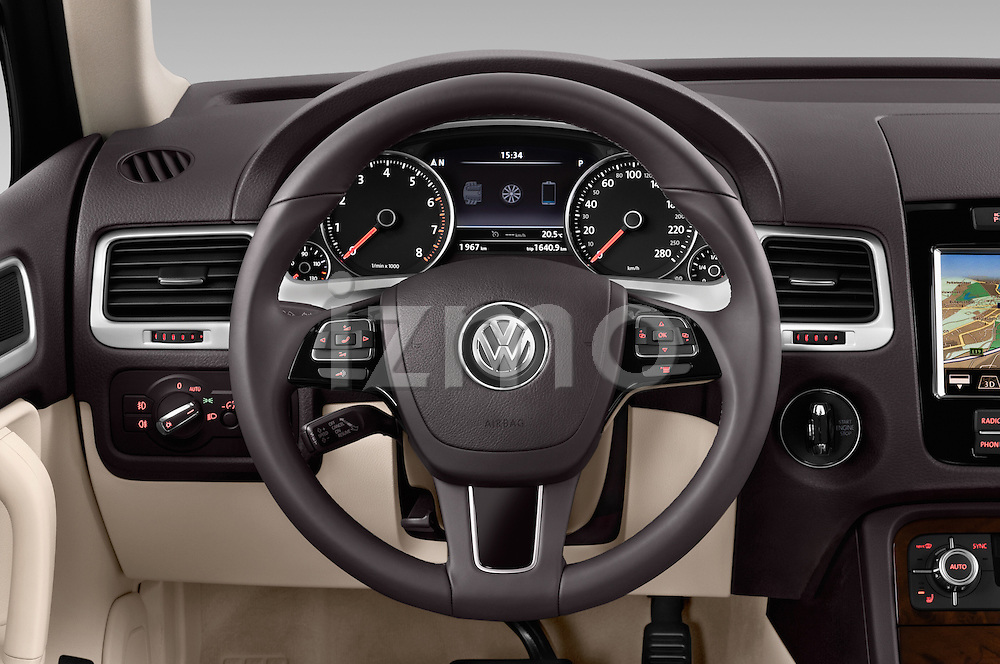 Car pictures of steering wheel view of a 2014 Volkswagen Touareg Hybrid 5 Door SUV 2WD Steering Wheel