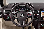 Car pictures of steering wheel view of a 2014 Volkswagen Touareg Hybrid 5 Door SUV 2WD Steering Wheel