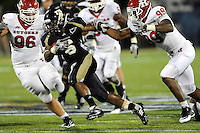 11 September 2010:  FIU running back Jeremiah Harden (6) breaks away from Rutgers defensive end Jonathan Freeny (99) for extra yardage in the third quarter as the Rutgers Scarlet Knights defeated the FIU Golden Panthers, 19-14, at FIU Stadium in Miami, Florida.